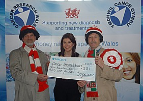 Presenting a cheque to Cancer Research Wales.