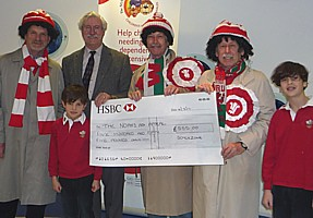 Presenting a cheque for the Noah's Ark Appeal at the Children's Hospital for Wales.