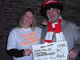 Sarah Morgan receives a cheque for �8 on behalf of Lung Cancer Campaign - Carmarthenshire from Hugh of Boycezone.