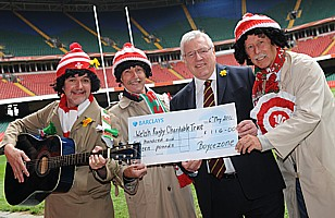 Handing the collection to WRU President, Dennis Gethin.