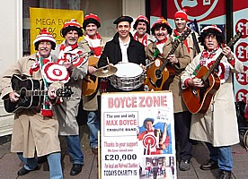 Click for pictures of Boycezone singing on the streets of Cardiff before the Wales - France Grand Slam rugby international 2012, collecting for Touch Trust.